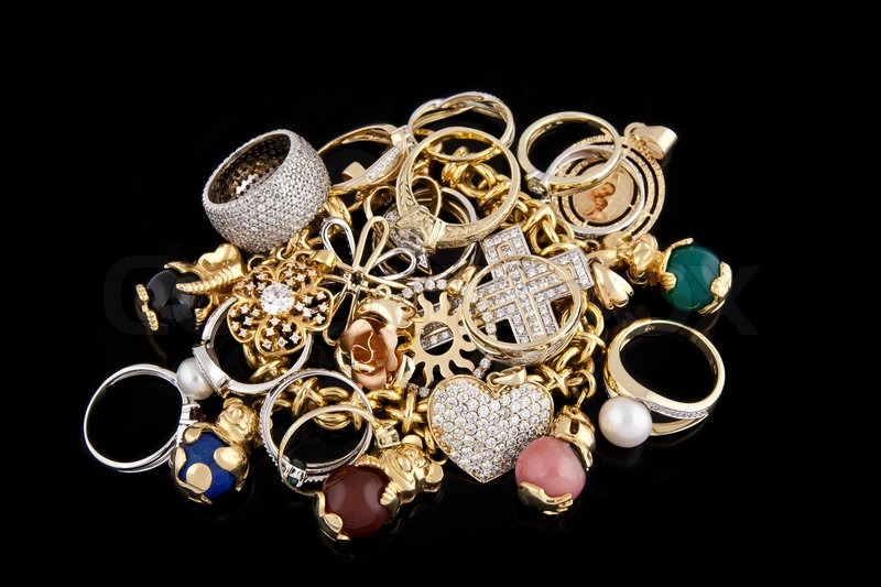 Gold Jewelry On A Black Background Stock Photo Colourbox