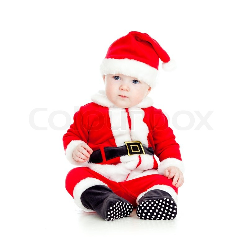 funny little kid in santa claus clothes stock photo