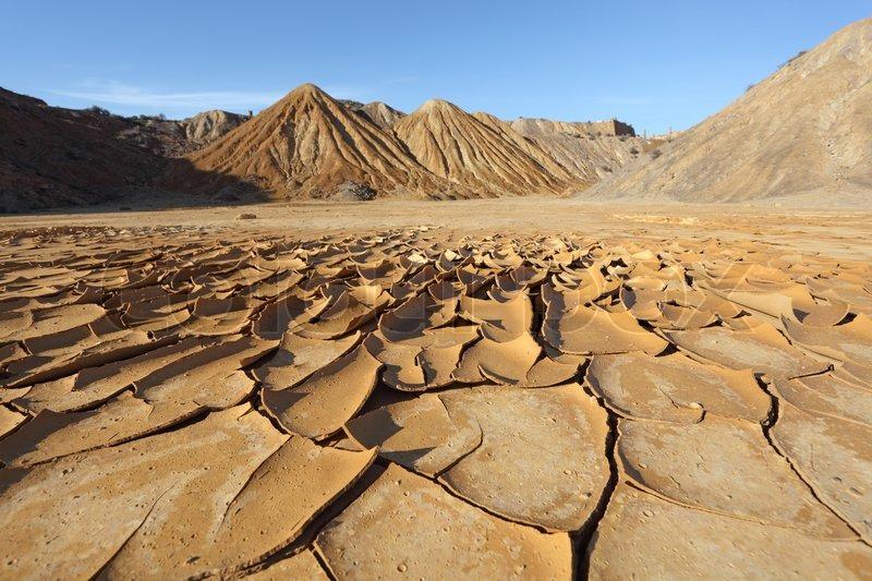 Cracked soil in the desert   Stock Photo   Colourbox