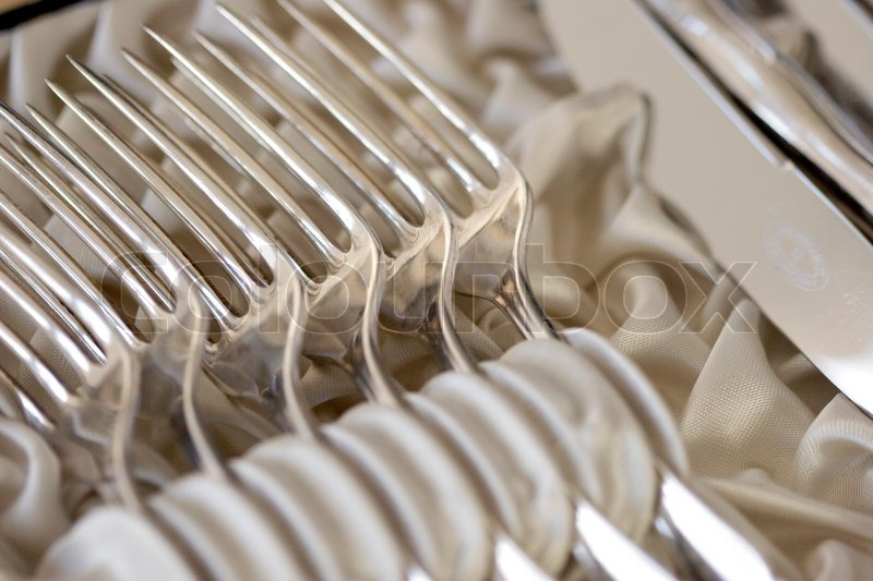 & Silver cutlery in cutlery case with white silk | Stock Photo | Colourbox