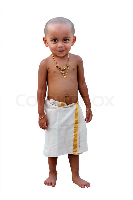 Cute and handsome happy indian boy with naughty smile ...