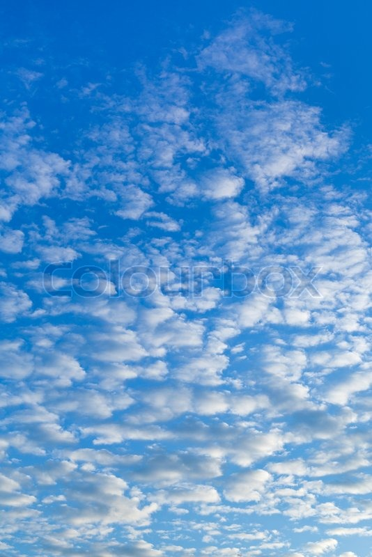 White cumulus clouds in blue morning sky, stock photo