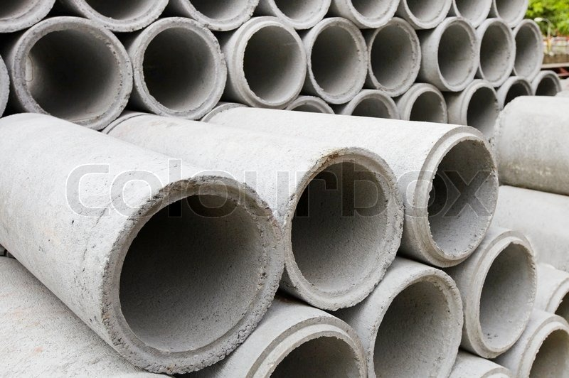 Concrete Drainage Pipe Sizes : Stacked concrete drainage pipes stock photo colourbox