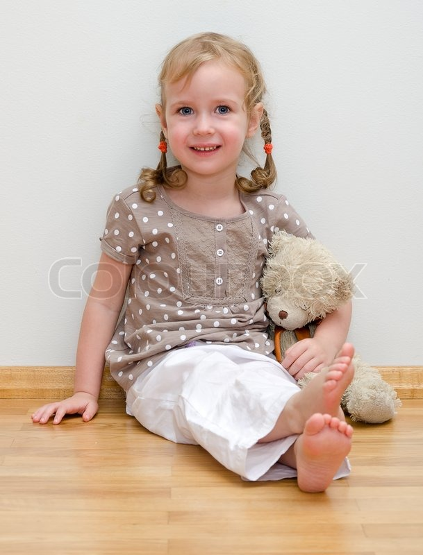 cute little girl sitting with teddy stock photo colourbox. Black Bedroom Furniture Sets. Home Design Ideas