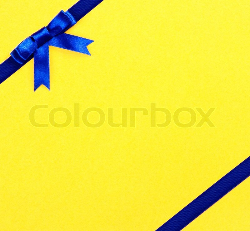 blue ribbon bow on yellow background stock photo colourbox. Black Bedroom Furniture Sets. Home Design Ideas