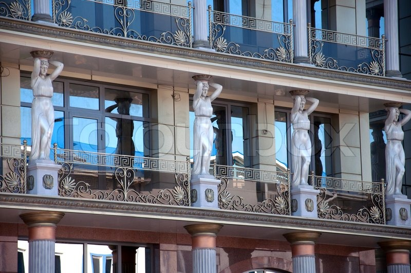 Modern Greek Architecture caryatids on the facade of a modern building, stylized greek style