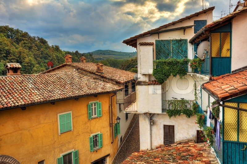 Fragment of small italian town with colorful houses roofs covered by