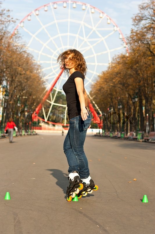young girl roller skates in the park