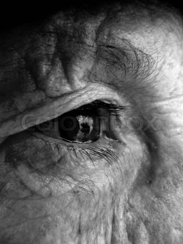Oldgrandmafaceeyesbwblack and white stock photo