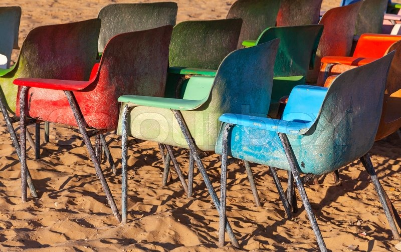Old Weathered Colorful Plastic Chairs On The Beach   Stock Photo   Colourbox