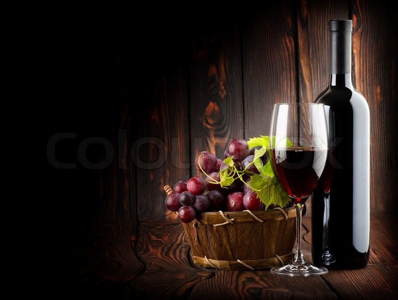 Wine On The Dark Wooden Background Stock Photo Colourbox