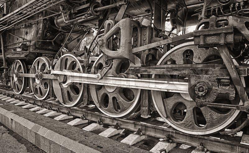 Old steam locomotive wheels, stock photo