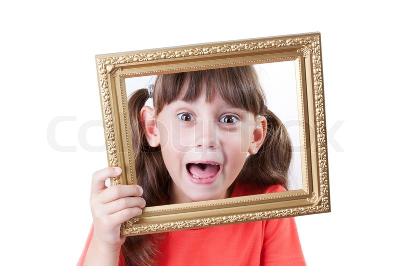 Little girl holding a frame for pictures | Stock Photo | Colourbox
