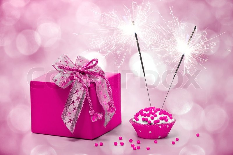 Birthday cake with sparkler and gift     | Stock image
