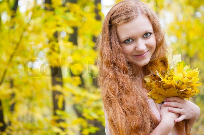 redhead girl with yellow autumn leaves stock photo colourbox. Black Bedroom Furniture Sets. Home Design Ideas