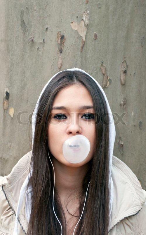 cute naked woman blowing bubblegum