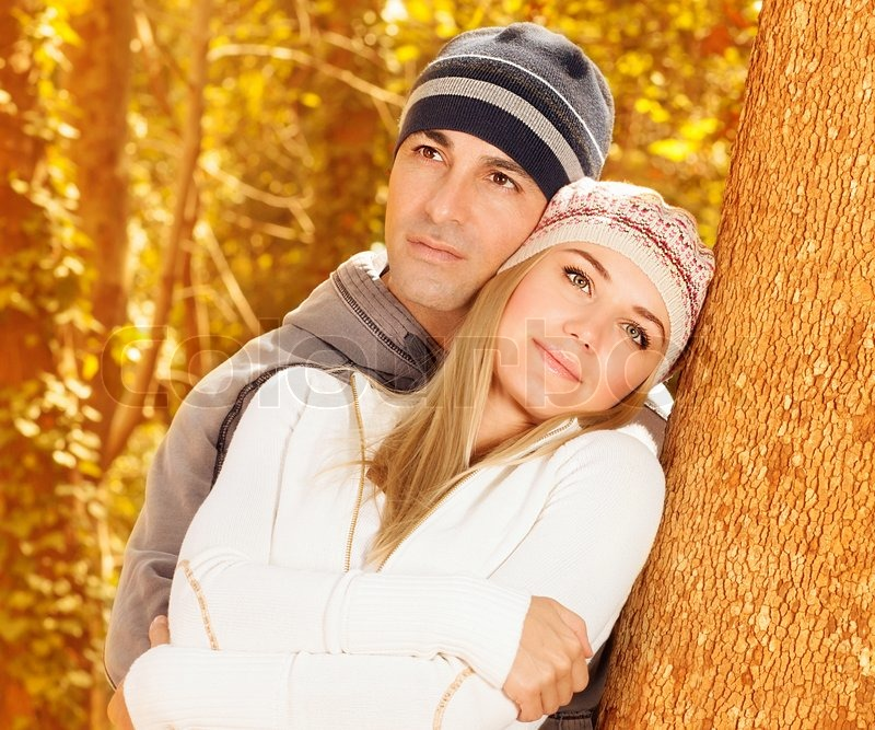 Closeup Portrait Of Cute Couple Hugging In Autumn Park Young Family Having Fun Autumnal Woods Boyfriend With Girlfriend Enjoying Fall Nature On