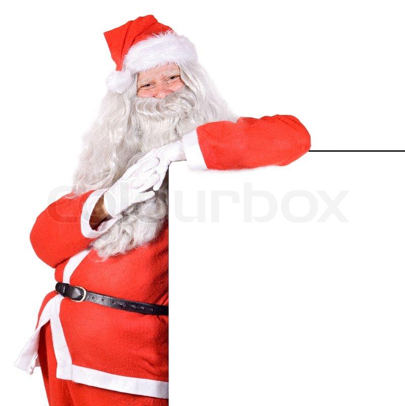 santa claus holding a blank sign stock photo colourbox