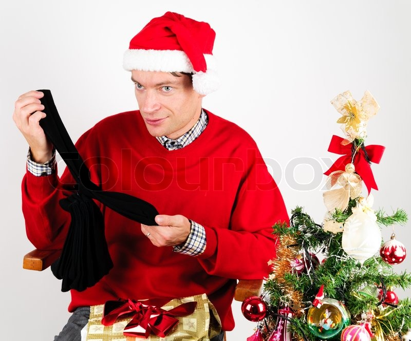 Man in red sweater unwrapping a Christmas gift | Stock Photo ...