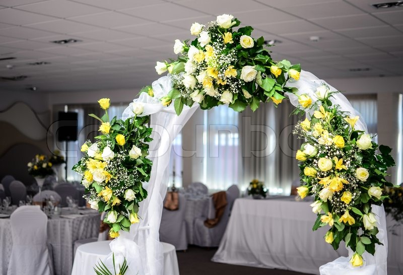 Beautiful wedding flower arch decoration in restaurant stock photo beautiful wedding flower arch decoration in restaurant stock photo colourbox junglespirit Gallery