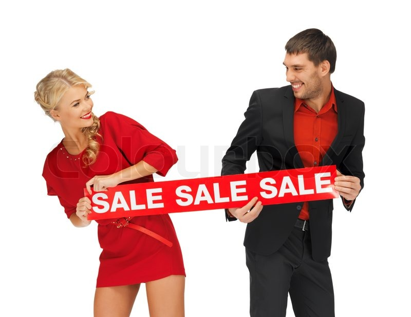 Man and woman with sale sign, stock photo