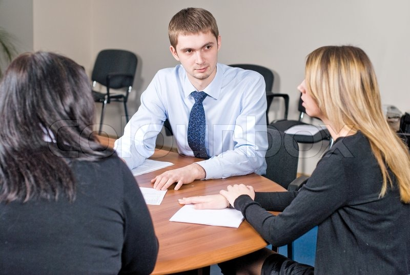Stock image of 'Business meeting in an office'