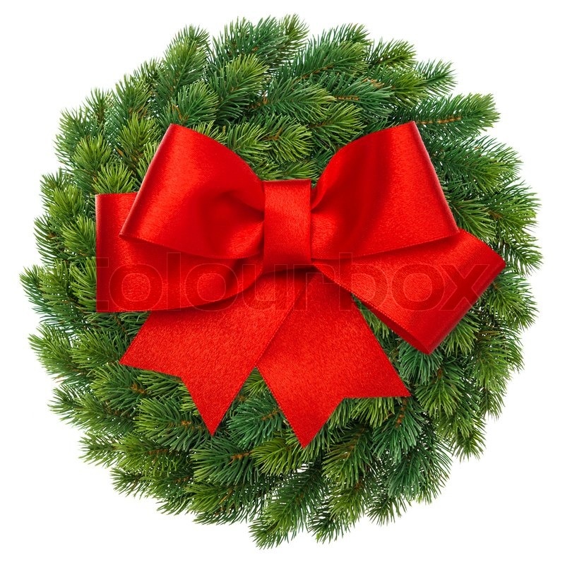 Green christmas wreath with red ribbon bow stock photo