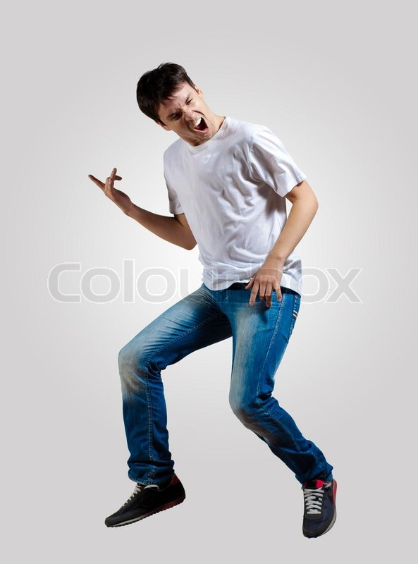 Young man dancing and jumping   Stock Photo   Colourbox