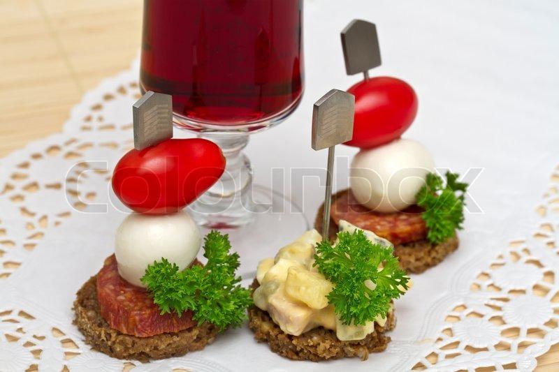 Canape with a mozzarella and tomatoes stock photo for Mozzarella canape