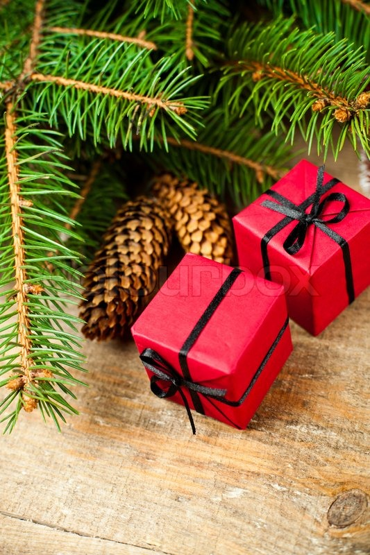 Christmas fir tree with pinecones and decorative boxes on a wooden board, stock photo
