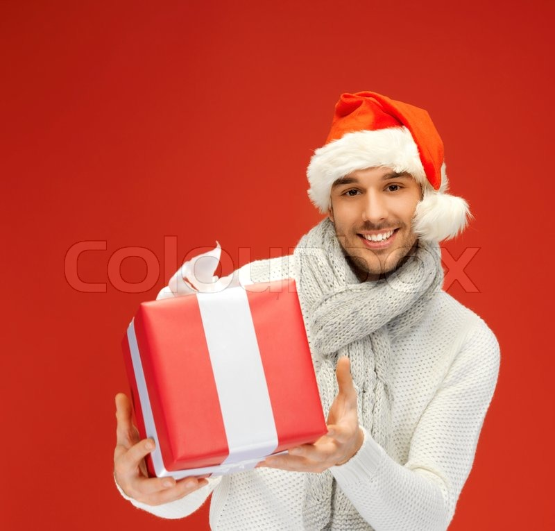 Handsome man in christmas hat | Stock Photo | Colourbox