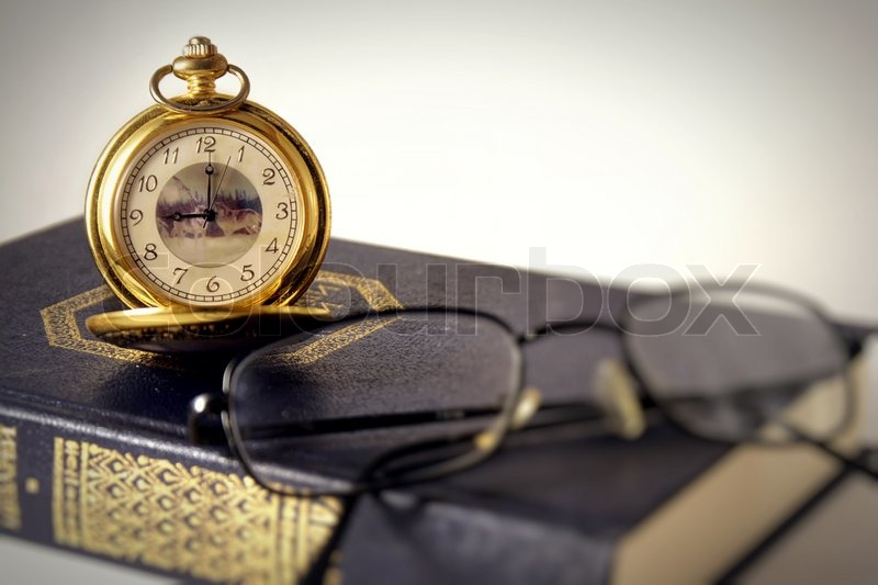 Antique clocks and book, stock photo