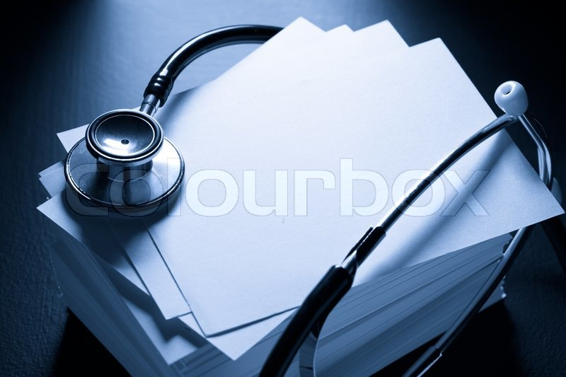 Stethoscope and heap of paper cards, stock photo
