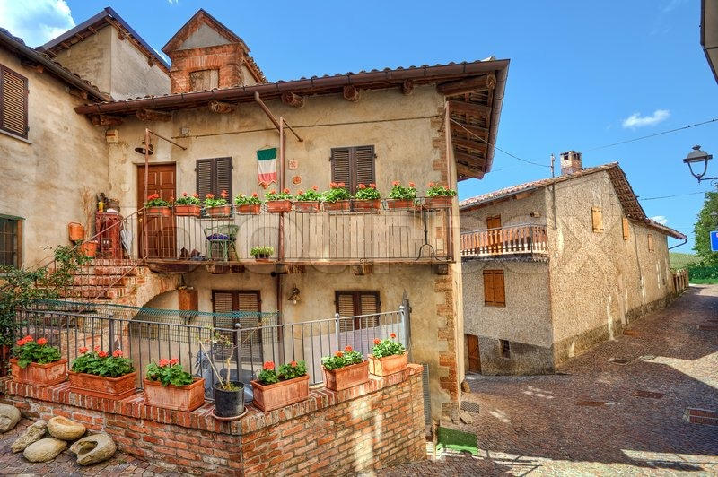 Traditional houses on narrow cobbled street of Barolo town in Piedmont,  Northern Italy. | Stock Photo | Colourbox