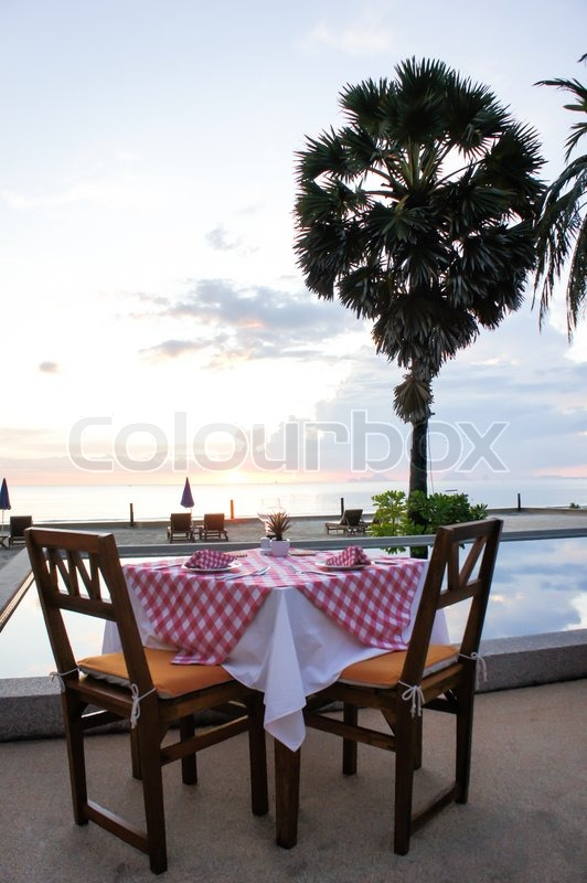 Stock image of 'Beach front dining'
