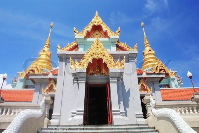 Beautiful thai buddha temple with blue sky background, stock photo