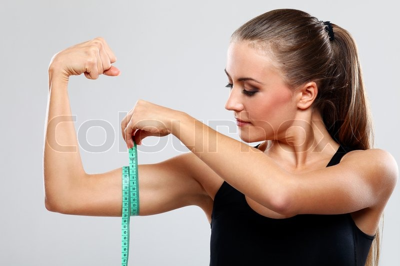 beautiful girl measure her biceps with a ruler stock photo colourbox. Black Bedroom Furniture Sets. Home Design Ideas