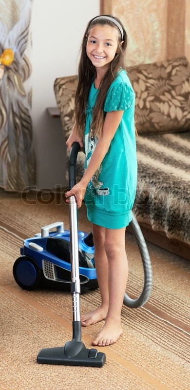 The Girl Is Vacuuming Stock Photo Colourbox