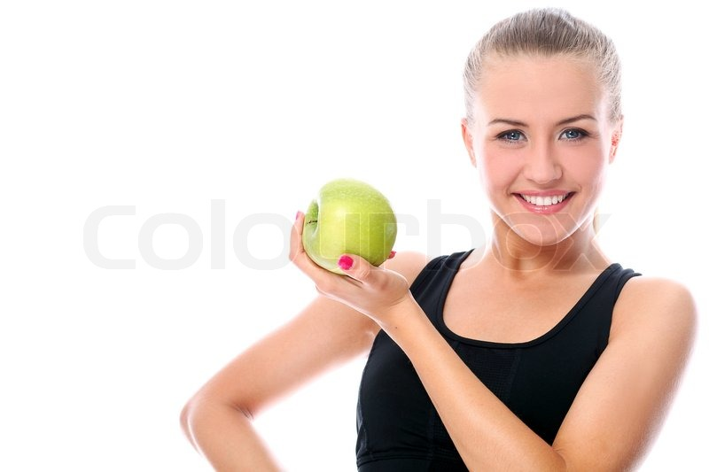 Beautiful fitness girl with green apple in hand stock photo