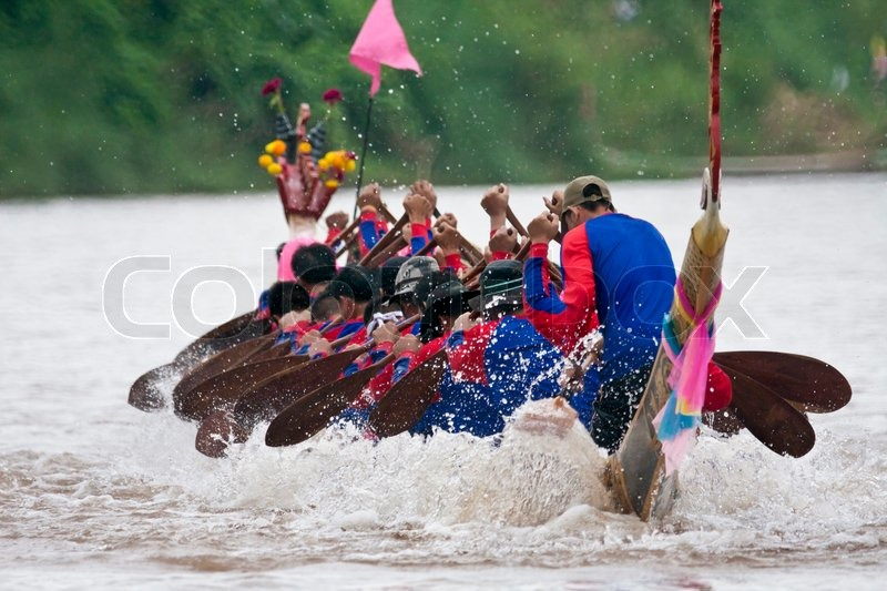 NAAN THAILAND - SEPTEMBER 26: Unidentified boat team activity in the Naan Boat race on Sept 26, 2009 in Naan, Thailand, stock photo