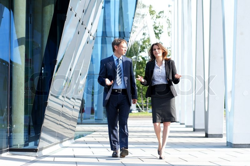 Business people walking and talking in the street, stock photo