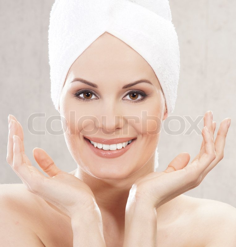 Spa portrait of young attractive woman in towel, stock photo