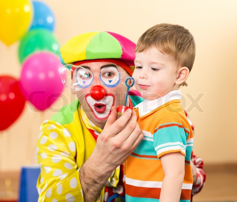 Joyful kid with clown on birthday party stock photo for Face painting clowns for birthday parties