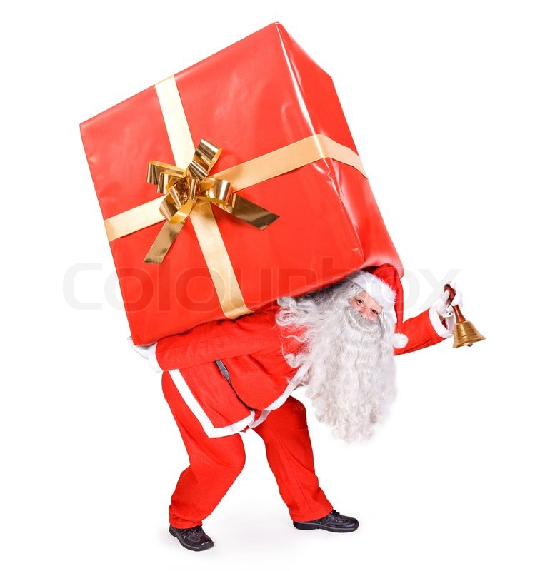 Santa Claus carries a big gift | Stock image | Colourbox