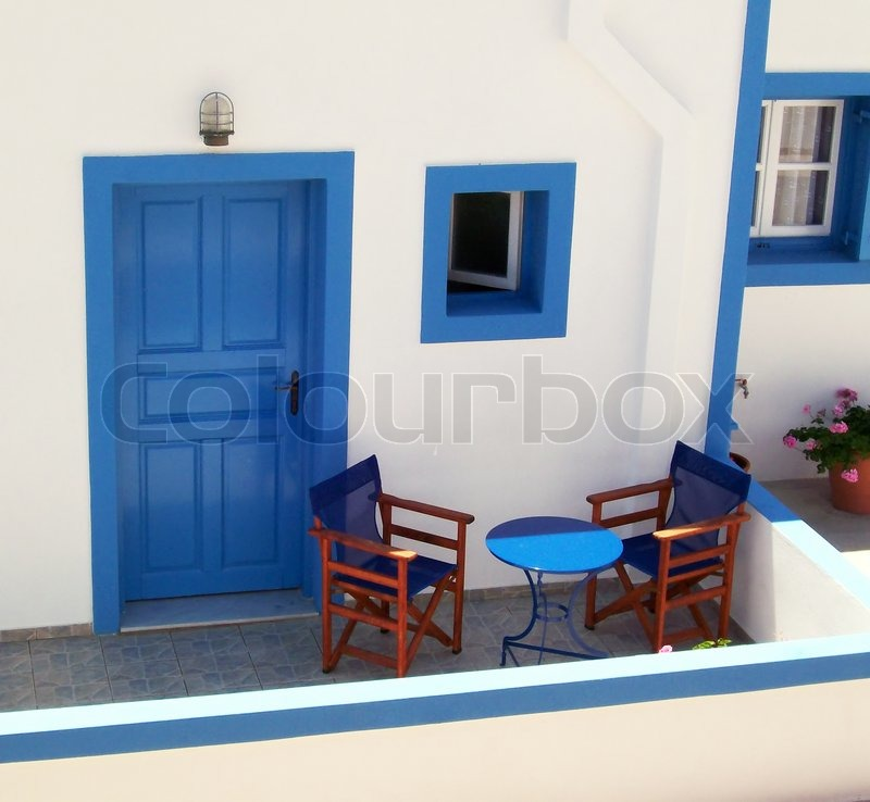 Greek house with typical blue and white trimmings stock for Blue and white house