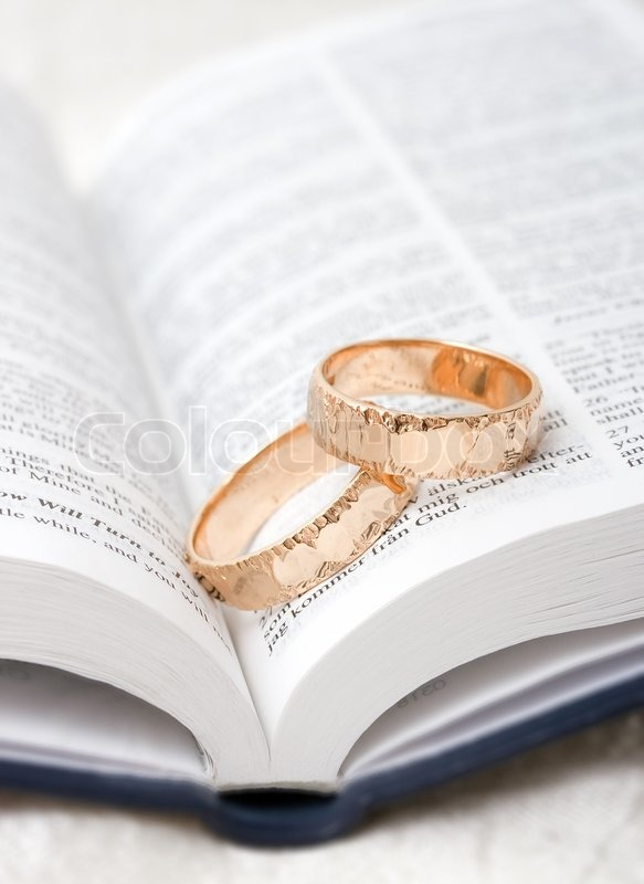Wedding Rings On A Bible Stock Photo Colourbox