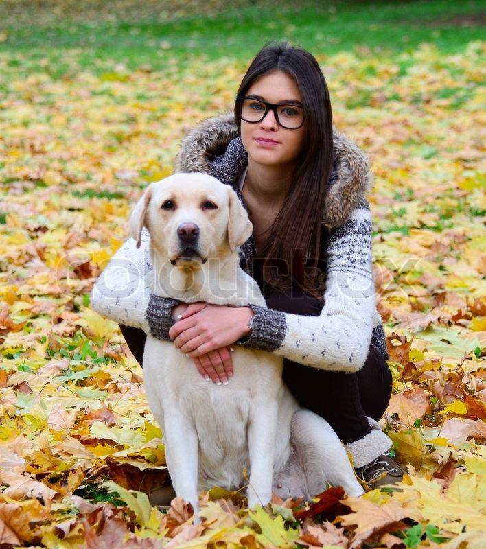 Beautiful girl with labrador retriever  | Stock image