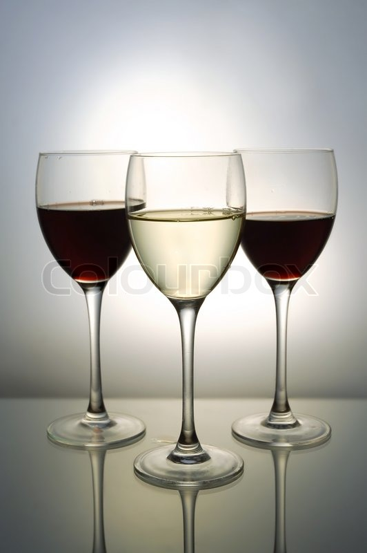 Three glasses with red and white wine, stock photo