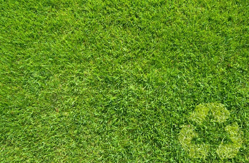 Recycle On Green Grass Texture Background Stock Photo