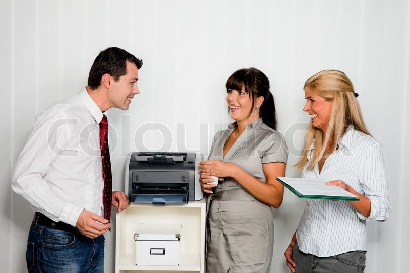 Conversation among office workers, stock photo